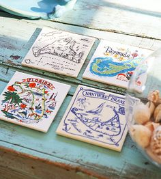 Show Off Souvenirs:   Tourist souvenirs make the perfect coffee table decor. These ceramic travel trivets double as coasters.