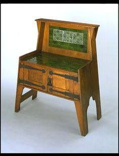 Washstand / London, England / after 1894 / Leonard F. Wyburd (probably, designer) / oak, with iron fittings and ceramic tiles