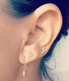 Summer Goodies! Just in time to get your Ear Game on, this ear story features a 14K gold and diamond safety pin and topped off with a mini-triangle and lightning bolt, both in 14K gold and diamonds. Get this look now from the Earstylist by Jo Nayor. www.EarStylist.com