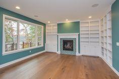 Upper level sitting room: custom painted built-ins, painted mantle, custom mosaic tile surround, hardwood floors