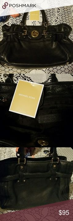Black Michael Kors used purse Used Michael Kors black purse with original tissue paper.  This purse still has a lot of life in it. Normal wear of useage but like i said it has a lot of life left.  Make offer or bundle a deal to save 30%.     17inches long 6 inches wide Michael Kors Bags Hobos