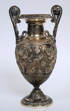 Selling for £1,900 - A George V silver two handled vase
