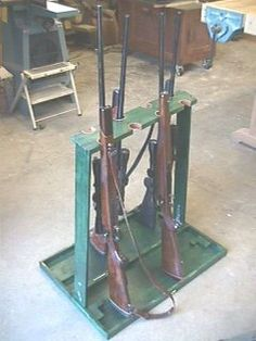 This is your woodworking search result for FREE GUN RACK PLANS woodworking plans and information at WoodworkersWorkshop® Woodworking Tools List, Woodworking Bench Plans, Woodworking Workshop, Teds Woodworking, Wall Clock Plans, Gun Cabinet Plans, Rifle Rack, Gun Rooms, Gun Storage