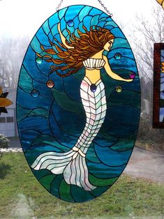 AmberLyn's Mermaid - This Mermaid panel is about 34 inches long and contains rainbow dichroic laminated to gems stones throughout.