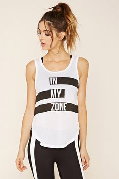"""A knit tank with a front """"In My Zone"""" graphic and a high dolphin hem."""