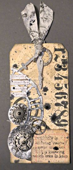 January @Tim Holtz  Tag http://nicollelovesscrapbooking.blogspot.com/2014/01/january-tim-holtz-tags-of-2014.html