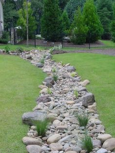 A properly located, carefully planned and installed dry creek bed. A properly located, carefully p Dry Riverbed Landscaping, River Rock Landscaping, Hillside Landscaping, Landscaping With Rocks, Outdoor Landscaping, Front Yard Landscaping, Landscaping Ideas, Inexpensive Landscaping, Backyard Drainage
