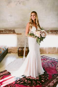 Lace wedding dress + blush bridal bouquet   Image by Kelly Giarrocco Photography