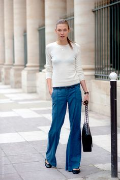 Karlie Kloss: Love the wide leg denim trousers, black flats, black handbag and a simple white long-sleeve. Comfortable and chic.