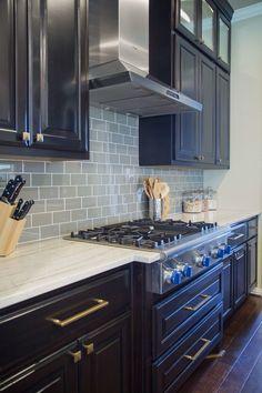 Superieur Macabus White Quartzite Countertops With Solid Color Glass Tile Backsplash  | Designer: Carla Aston,