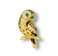 A DIAMOND, EMERALD AND ONYX CLIP BROOCH, BY VAN CLEEF & ARPELS - Christie's