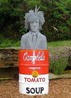 I am not talented enough to make the chicken-wire sculpture but I love this burn barrel painted to look like a Campbell's tomato soup can.  I could do that with stencils.