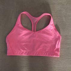 Victoria's Secret VSX The Player Sports Bra Victoria's Secret VSX The Player Racerback Sports Bra. Size L. Beautiful pink with mesh detail on back. 77% nylon/ 23% elastane. EXCELLENT CONDITION! No trades.. Victoria's Secret Tops Crop Tops