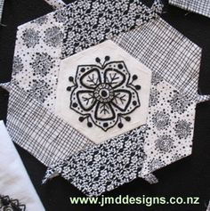 Pretty embroidered block I like the use of the black and white fabrics. I'd do the center embroidery in red, though.
