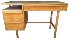 This is a stunning Mid-Century Modern desk made by the USA company, Sligh.  It has two side drawers and third center drawer. It is all wood and had just been professionally refinished with a wax finish.