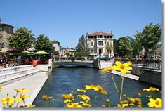 """The Isle le sur la Sorgue is an """"island city"""" with an extremely colorful nature. The silk and paper industries used the great wheels turning in the water to create their local products many years ago. You can walk along the canals and stroll past the local vendors in this charming place with ancient streets."""
