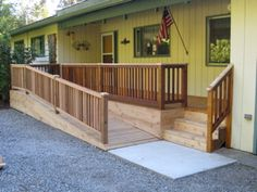 deck front porch - with ramp - but needs bushes and garden in front to hide the ramp