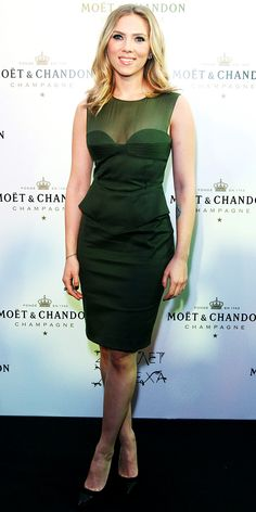 Gorgeous hair, makeup and dress. Scarlett Johansson attended the Moet & Chandon anniversary bash in an illusion neckline peplum dress and pointy-toe pumps.