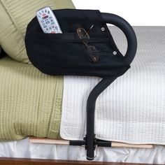 BedCane and BedCane Organizer by Stander - helps you get in and out of bed safely.  Includes a 4-pocket organizer.  Its also portable.  $129.99 includes Free doorstep delivery.