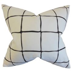 Add a textured look to your living room furniture or bed when you toss this throw pillow on it. The black lines offer a stark contrast to the white background for a stunning look. The checked pattern is an ideal complement for any decor.