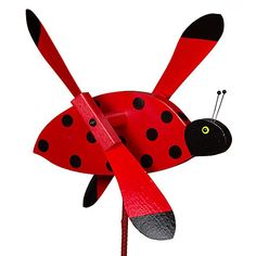 They say that finding a ladybug in your home is good luck. While this Ladybug Whirly Bird Whirligig Wind Spinner is designed to go outside, but not inside, you're sure to agree that it's one lucky fin