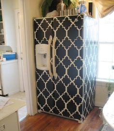 Another renter friendly project. I covered my kitchen cabinets with contact paper. Looks good but would have been cooler if I had made my own pattern like this.