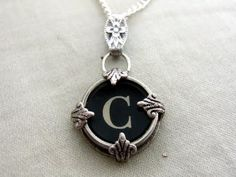 I love this pendant by QA CREATE! It has been made using a polished vintage typewriter key from the 1930's - 1940's. http://www.etsy.com/shop/qacreate