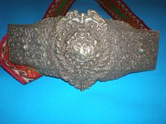 Large buckles are cast and hand-made of a metal from from the early 20th century