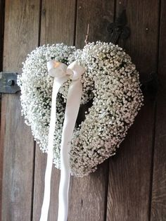 Hearts of Gypsophilia hung on the church doors
