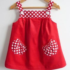 Jumper Dress, Red Pinwale Velvet, Sizes 6 months, 3 - this design would be cute with Minnie and mickey on the pockets or chicks or bunnies or sailboats, eInspiration for a Popover Sundress with Puppet Show shorts pocketsGirls Red Gingham Dress Baby G Toddler Dress, Toddler Outfits, Kids Outfits, Baby Dress Design, Frock Design, Frocks For Girls, Kids Frocks, Baby Girl Fashion, Kids Fashion