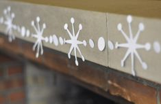 credit: Chris Gardner [http://www.curbly.com/users/chrisjob/posts/7635-curbly-video-podcast-how-to-make-a-mod-paper-snowflake-garland]