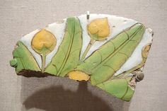 Tile Fragment with Mandragora Fruit and Leaves - Egypt, probably el Amarna, New Kingdom, late Dynasty 18, reign of Akhenaten, c. 1352-1336 BC, polychrome faience - Brooklyn Museum - Brooklyn, NY