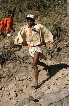 The Tarahumara, a community of indigenous people of northwestern Mexico known for their long-distance running ability.  They run multiple marathons on stony trails, wearing thin home-made sandals, without cushioning. They have adapted to the thin mountain air and their lung capacity and stamina makes them among the best endurance runners in the world.