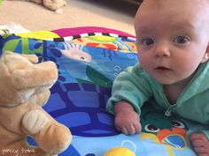 madison-on-playmat-looking-at-toys