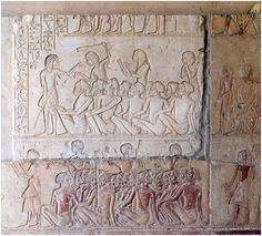 Second courtyard relief showing the representations of Egyptians looking over foreign Nubian/Sub-Saharan captives before Horemheb. Tomb of Horemheb, Saqqara.