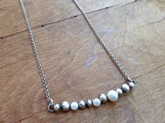Handmade Sterling and white freshwater pearl bar necklace by our friends at J&I Jewelry