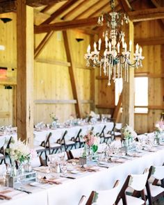 Swanky chandeliers lit this rustic reception site in Tabernash, Colorado