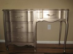 Relove: Tarnished French Provincial Desk -Gold metallic paint with black glaze finish...so cool!