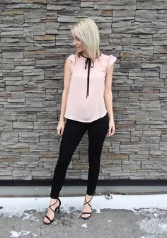 Spring 2017 style, blush blouse with tie, black pants, heels