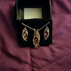 Earring and necklace set Chocolate shimmer necklace and earring giftset. Brand new. I have two of these sets. Avon Jewelry Earrings