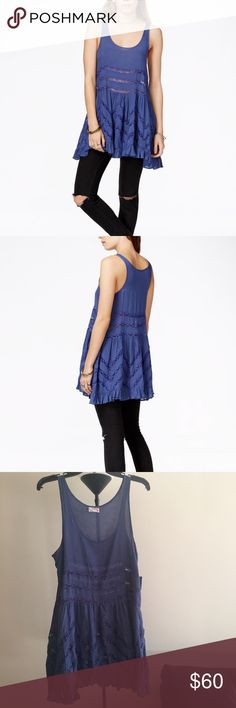 Free People Lace-Trim Printed Trapeze Slip Dress Embrace your inner child with this tunic-dress: it will totally inspire you to skip, twirl & maybe even make daisy chains. Delightfully dainty waterfall color!  • Detail: Micro polka-dots all over; lace detailing throughout & 2-inches ruffle along bottom • Scoop neckline • Sleeves: 1-1/4-inches wide • 100% rayon • Care Instructions: Hand wash cold. • Romantic lace details a breezy trapeze style • Sleeveless pullover style • Measurements…