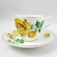 Pretty Royal Grafton tea cup and saucer with yellow roses. Gold trimming on cup and saucer edges. Excellent condition (see photos). Markings read: Royal Grafton Bone China England Please bear in mind that these are vintage items and there may be small imperfections from age or flaws