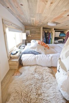 Bedroom loft in a tiny home. Love all the various shades of white and off-white in this bedroom. I love the wood too. (Photo only)