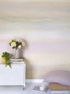 Raw concrete and plywood are robust counter-balances to the Resene Blanched Pink feature wall behind this bed in a house designed by Studio Pacific Architecture. Watercolor Walls, Watercolor Effects, Watercolour, Pink Feature Wall, Architrave, Rainbow Wall, Paint Effects, Pink Accents, Upcycled Furniture