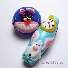Return to Wonderland.  A couple Alice inspired lampwork glass beads by Heather Sellers.
