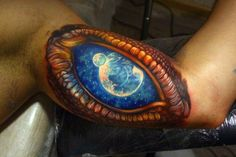 If you're looking for something a little different, a dragon eye tattoo may be just the thing. Check out SloDive's treasure chest of tattoo designs now! 3d Tattoos, Sleeve Tattoos, Cool Tattoos, Dragon Tattoos, Space Tattoos, Awesome Tattoos, Realistic Eye Tattoo, 3d Fantasy, Dragon Eye