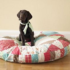 Use up those fabric and batting scraps to make the filling for a dog/cat bed!  Great idea!!