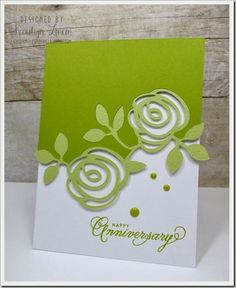 habdmade anniversary card ... chartreuse and white ... love how the die cut wild rose branch in lighter greeb is fitted into the top panel and overlaps the bottom ... fantatic paper engineering ... great card!!