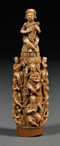 Carved Goat Ivory Group with Musicians, surmounted by a harpist, with columns of relief-carved figures and a unicorn, ivory
