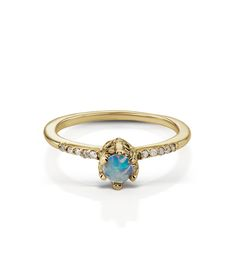 4a985547e yellow gold with Opal ring with one round rose cut Opal, with pave of white  Diamonds This style features an Australian Opal.